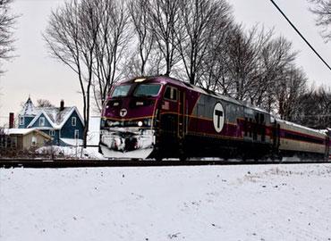 a purple train in a snowplace